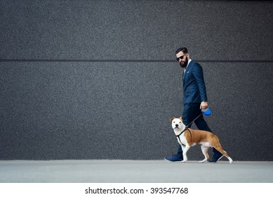 Businessman walking with his dog.