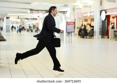 Businessman Walking in a hurry isolated on a white background