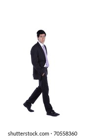 Businessman walking isolated on white (some motion blur)