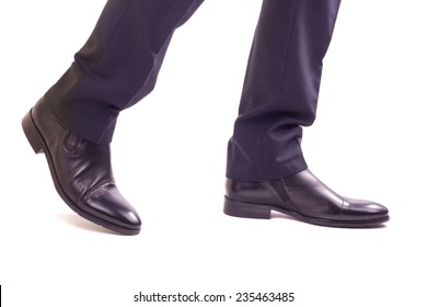 Businessman walking legs isolated on white background