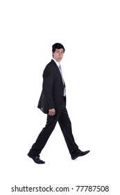 Businessman walking and looking to you isolated on white (some motion blur)