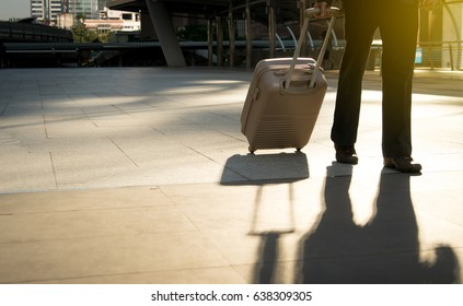 businessman walking with luggage, beginning day transport to office.