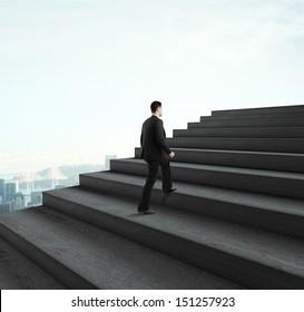 businessman walking near ladder in sky