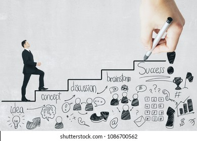 Businessman walking on drawn business stairs on concrete background. Leadership and startup concept