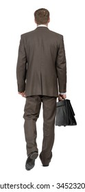 Businessman walking on isolated white background, rear view