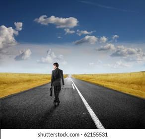 Businessman walking on a road