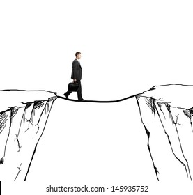 businessman walking on rope from rock to rock