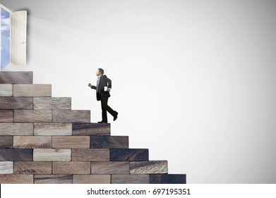 Businessman walking on stair wood to door of success