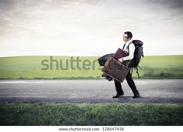 businessman walking on the street with a lot of luggage