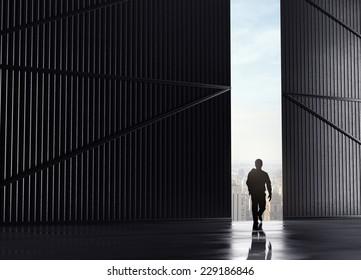 businessman walking and open doors to city