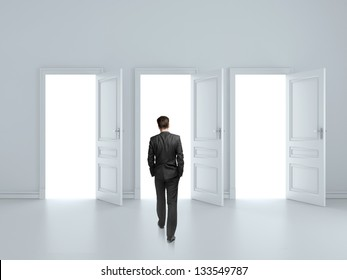 businessman walking to opened three door