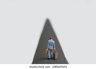 Businessman walking road with his luggage.