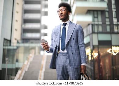 Businessman walking in the street fiercely