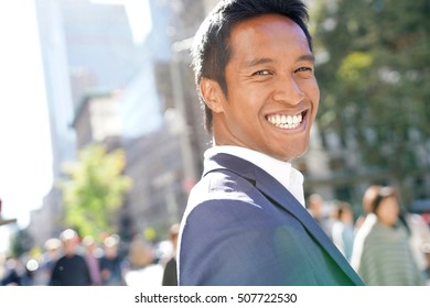 Businessman walking in the streets of Manhattan