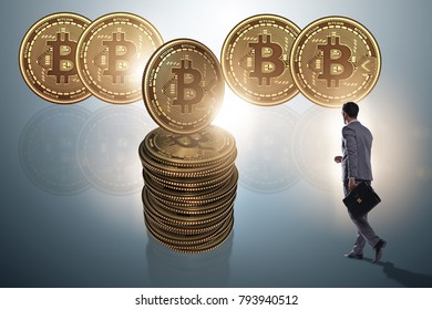 Businessman walking towards bitcoins in cryptocurrency blockchai