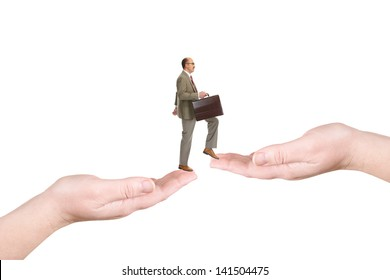 The businessman walks on palms, isolated over a white background