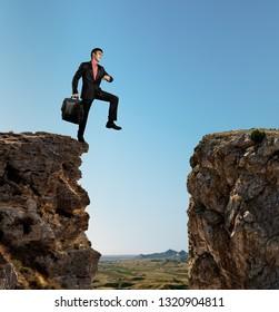 businessman walks through an abyss, business concept