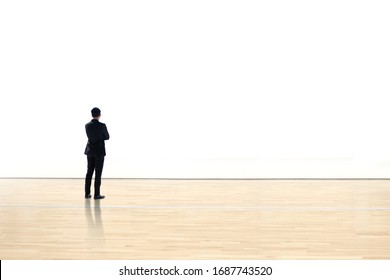 Businessman watching  blank space wall in modern gallery, Art exhibition minimal concept,