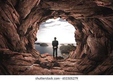 businessman watching out of tunnel