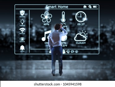 Businessman watching smarthome interface on a rooftop with a city view 3D rendering