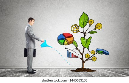 Businessman watering drawing tree consisted of infographics. Consultation and assistance. Financial tree as symbol investment growth. Professional crowdsourcing service. Business idea development