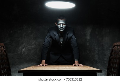 Businessman at wear mask to dark side and concept at dangerous.