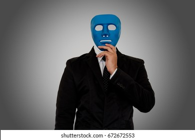 Businessman wearing blue mask on gray background with clipping path. Someone who wears a mask when socializing.