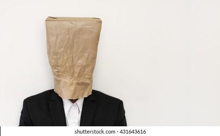 Businessman wearing brown paper bag