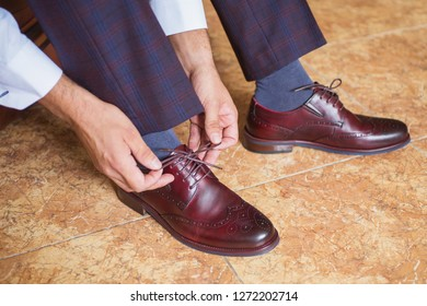 Businessman wearing brown stylish casual shoes. Casual style. Casual man