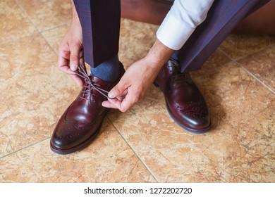 Businessman wearing brown stylish footwear. New stylish shoes. Businessman dresses classic footwear