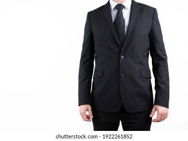 Businessman wearing an elegant suit over white background.