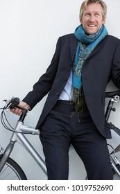 Businessman wearing extravagant scarf