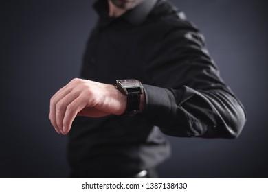 Businessman wearing luxury wristwatch. Business