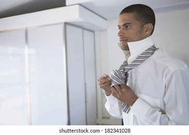 Businessman wearing up in the morning