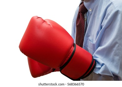 Businessman wearing red boxing gloves. Close up of the man in blue shirt with a necktie who fights in a business scene. The image is isolated on white.