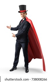 A businessman wearing a red cape and a big illusionist's hat shows something on a white background. Invite to show. Best performance. Corporate magician.
