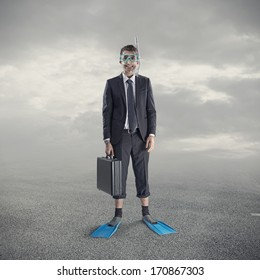 Businessman wearing scuba mask and flippers.