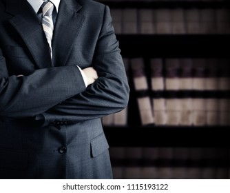 Businessman wearing a suit in front of a bookcase