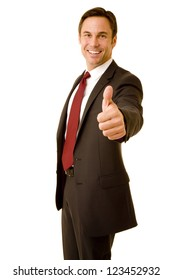 Businessman wearing a suit giving a thumbs up isolated on white