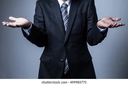 Businessman wearing a suit, Helpless, hand, give up, shrug, shoulders, do not know