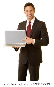 Businessman wearing suit pointing to a laptop computer isolated on white