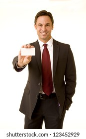 Businessman wearing suite holding a message card isolated on white