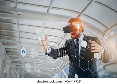 Businessman wearing virtual reality headset, people and technology concept