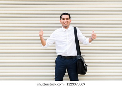 Businessman wearing white t shirt and blue pant with thumb up and bag on his shoulder with lifestyle trendy modern life.