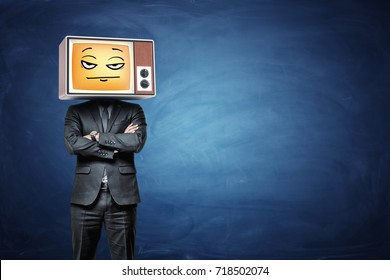 A businessman wears a retro TV on his head and broadcasts a yellow disappointed emoji. Tired of waiting. See no future. Loss of motivation.