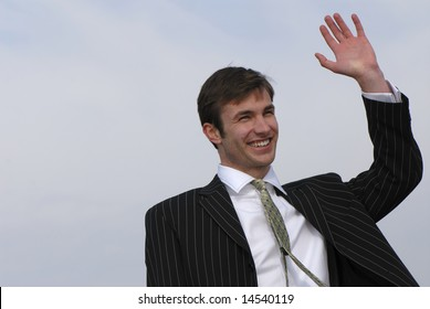 businessman welcomes  lifted hand on  background of  sky