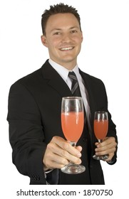 A businessman is welcoming you to a celeration and offering you a drink.