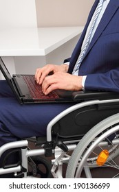 A Businessman in a Wheelchair with laptop