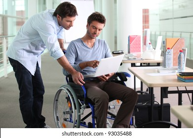 Businessman in a wheelchair on laptop