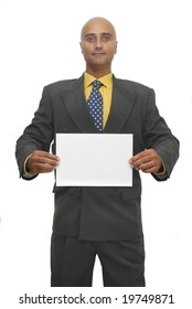 Businessman with a white card isolated against a white background